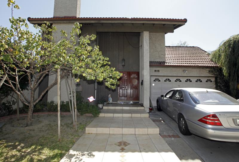 "A car sits parked at the suburban Los Angeles home believed to be that of filmmaker Nakoula Basseley Nakoula, Friday, Sept. 14, 2012. Federal authorities have identified Nakoula, a self-described Coptic Christian, as the key figure behind ""Innocence of Muslims,"" a film denigrating Islam and the Prophet Muhammad that ignited mob violence against U.S. embassies across the Middle East. (AP Photo/Reed Saxon)"