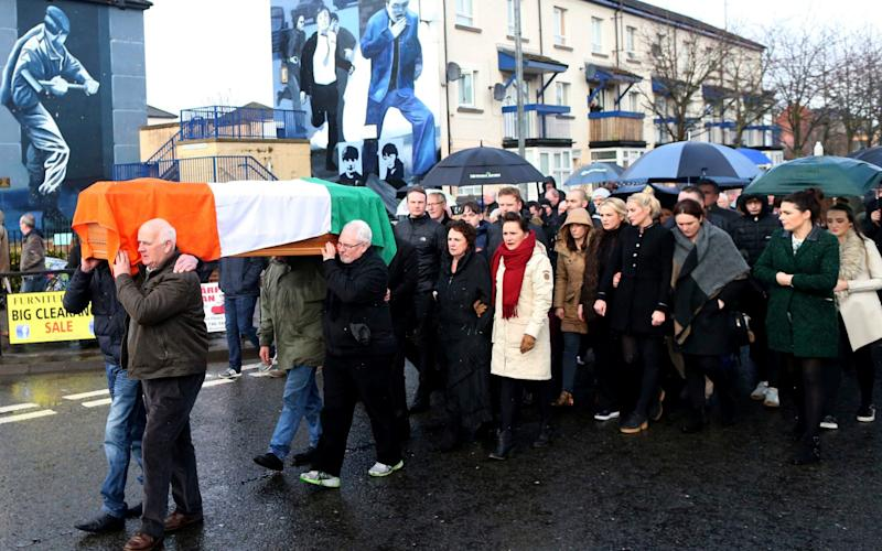 Irish Republicans carry the coffin of Martin McGuinness through the bogside area of Londonderry, Northern Ireland - Credit: Peter Morrison /AP