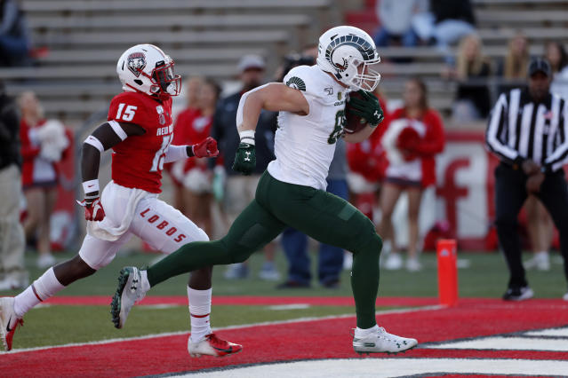Colorado State tight end Trey McBride, right, scores a touchdown past New Mexico safety Letayveon Beaton (15) during the first half of an NCAA college football game Friday, Oct. 11, 2019. in Albuquerque, N.M. (AP Photo/Andres Leighton)