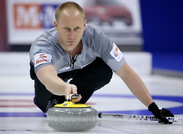 WINNIPEG, CANADA - DECEMBER 8: Skip Brad Jacobs throws a rock in the Men's Final against Team Morris at the Roar of the Rings Canadian Olympic Curling Trials on December 8, 2013 at MTS Centre in Winnipeg, Manitoba, Canada. (Photo by Trevor Hagan/Getty Images)