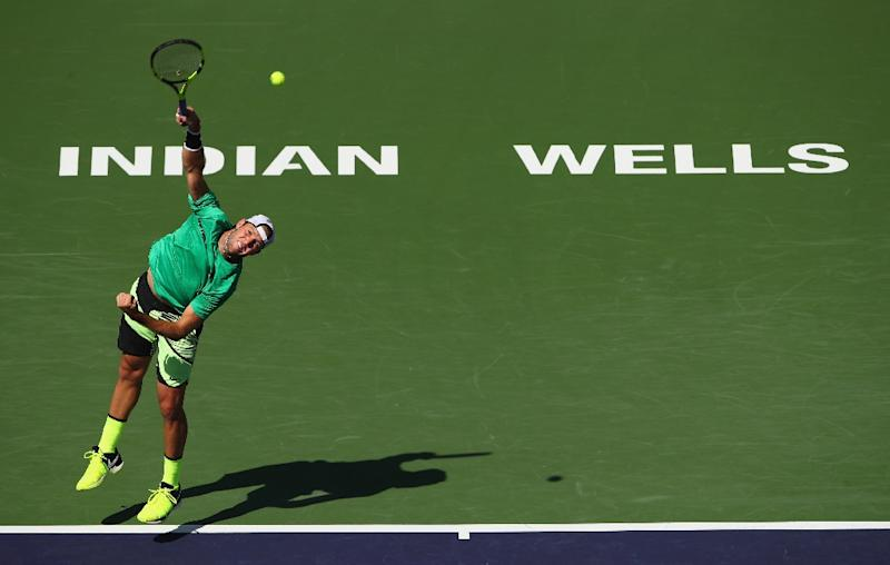 Jack Sock of the US serves against Kei Nishikori of Japan during their BNP Paribas Open quarter-final match, at Indian Wells Tennis Garden in California, on March 17, 2017