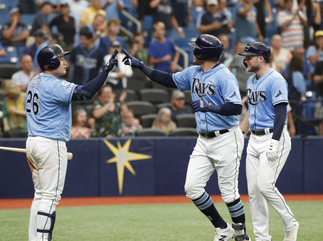 Tampa Bay Rays' Avisail Garcia, center, celebrates with teammate Ji-Man Choi after hitting a home run against the Toronto Blue Jays during the seventh inning of a baseball game on Sunday Sept. 8, 2019, in St. Petersburg, Fla. (AP Photo/Scott Audette)