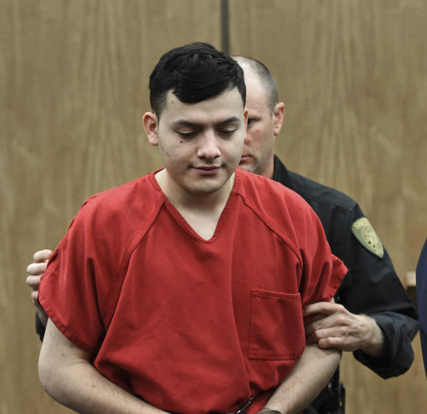 CORRECTS SPELLING OF NAME TO WILBER NOT WILBUR Wilber Martinez-Guzman, from El Salvador, is walked into the Washoe District Court in Reno, Nev., on Monday, May 20, 2019. Martinez-Guzman faces murder, burglary and weapons charges in the deaths of four people in northern Nevada in January. (Andy Barron/Reno Gazette-Journal via AP, Pool)