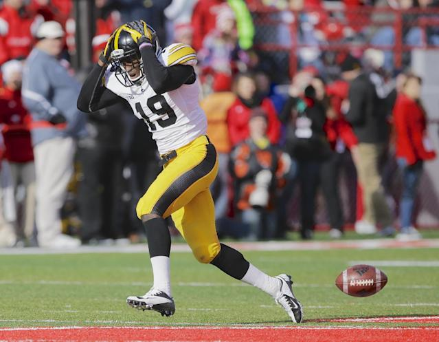 Iowa defensive back B.J. Lowery (19) reacts after nearly intercepting a ball thrown by Nebraska quarterback Ron Kellogg III in the first half of an NCAA college football game in Lincoln, Neb., Friday, Nov. 29, 2013. (AP Photo/Nati Harnik)