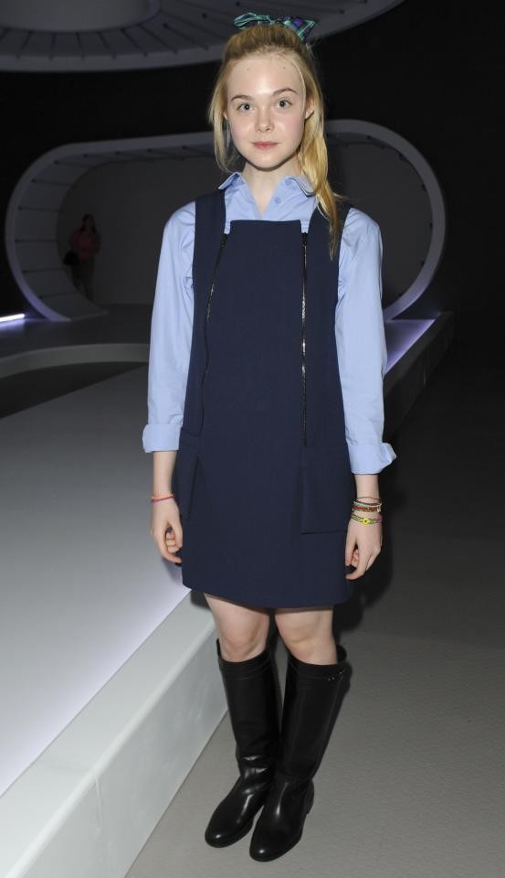 """<p class=""""MsoNormal""""><span>Looking like a schoolgirl (fitting, since at 14, she is one), actress Elle Fanning attended the front row for the Unique show at TopShop Venue. <br></span></p><p class=""""MsoNormal""""><span>(Photo by David M. Benett/Getty Images)</span></p>"""