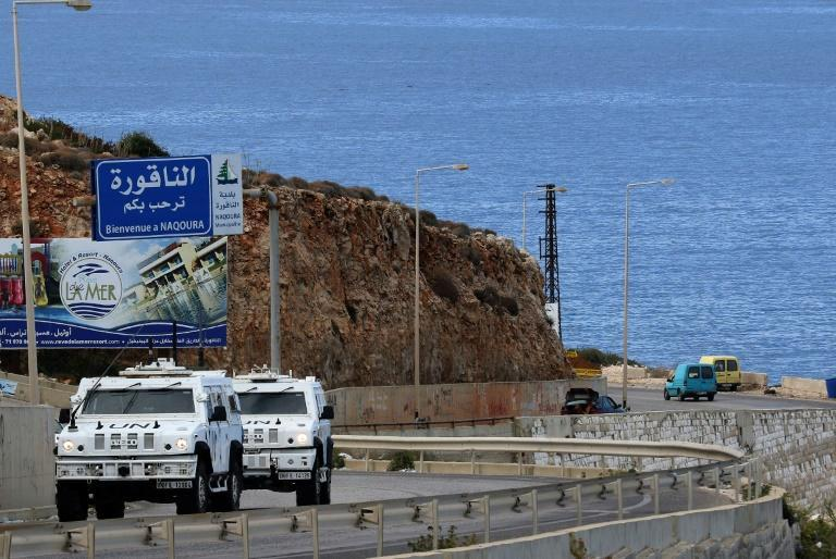 UNIFIL vehicles patrol the coastal road to Naqura, the southernmost Lebanese town by the border with Israel