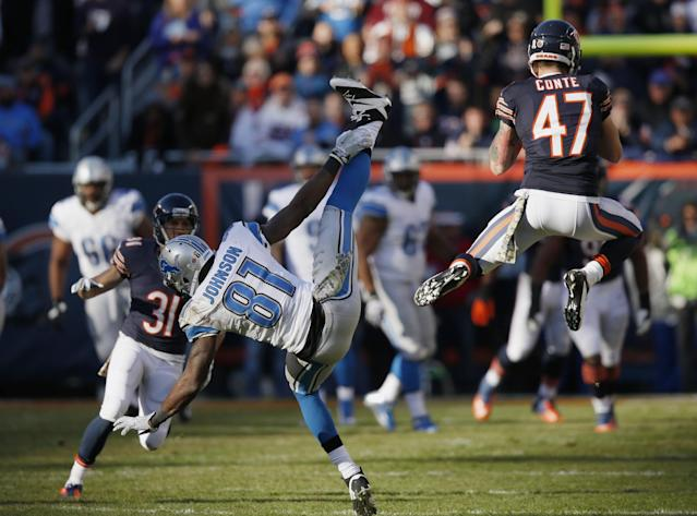 Chicago Bears safety Chris Conte (47) intercepts a pass intended for Detroit Lions wide receiver Calvin Johnson (81) during the second half of an NFL football game, Sunday, Nov. 10, 2013, in Chicago. (AP Photo/Charles Rex Arbogast)