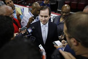 Sam Hinkie, center, tried to make things work with Jerry Colangelo. (AP)