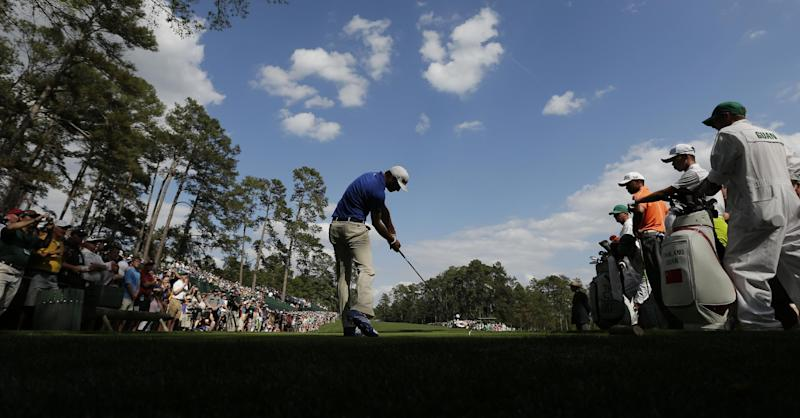 Amateur Guan Tianlang, of China, and Tiger Woods, third right, watch as Dustin Johnson tees off on the 14th hole during a practice round for the Masters golf tournament Monday, April 8, 2013, in Augusta, Ga. (AP Photo/Charlie Riedel)