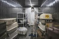 The 12-metre metal containers can store up to 40 corpses at a constant temperature of zero degrees Celsius