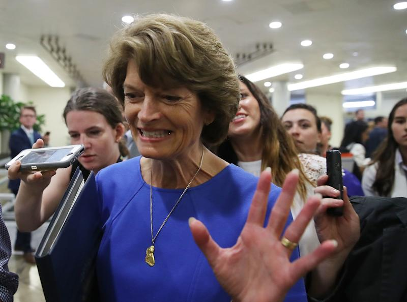 Sen. Lisa Murkowski (R-Alaska) flees reporters in July who were asking how she planned to vote on Obamacare repeal legislation. She stuck it to the president and her party leaders by helping to kill it. (Mark Wilson via Getty Images)