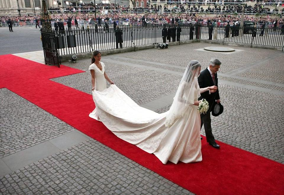 Kate Middleton wears a Sarah Burton Alexander McQueen dress for the Royal Wedding, 2011 (Getty Images)