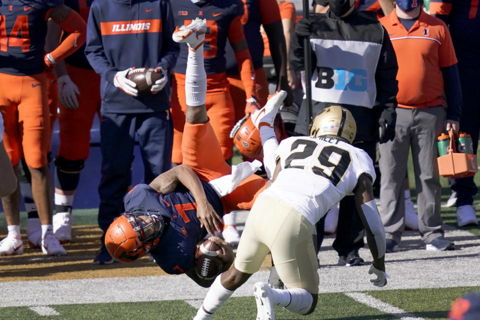 Illinois quarterback Coran Taylor (7) is upended by Purdue cornerback Simeon Smiley during the first half of an NCAA college football game Saturday, Oct. 31, 2020, in Champaign, Ill. (AP Photo/Charles Rex Arbogast)