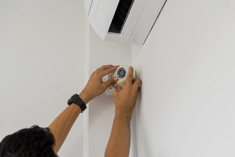 """<p>Whether you live in the quietest town or a major metropolitan city, break-ins can happen. """"Some easy, affordable home improvement projects which help deter break-ins are installing motion-sensor lights, a high fence around your yard, and burglar-proof windows and doors,"""" says Diane Vukovic, lead writer at <a href=""""http://primalsurvivor.net/"""" rel=""""nofollow noopener"""" target=""""_blank"""" data-ylk=""""slk:Primal Survivor."""" class=""""link rapid-noclick-resp"""">Primal Survivor.</a> """"You will also want to consider removing any trees or shrubs around windows as these make it easy for intruders to break in without being noticed.""""<br></p><p>Also, consider a home security camera or alarm system to monitor your house. Many high-rated camera options are available for under $100, while alarm systems can run about $10 a month. If you're looking for a quick DIY fix, you can also choose to install new door locks. """"Adding a swing lock to your front door can fortify its strength and make it harder for trespassers to enter your home,"""" says Kristen Bolig, founder of <a href=""""https://securitynerd.com/"""" rel=""""nofollow noopener"""" target=""""_blank"""" data-ylk=""""slk:SecurityNerd"""" class=""""link rapid-noclick-resp"""">SecurityNerd</a>.</p>"""