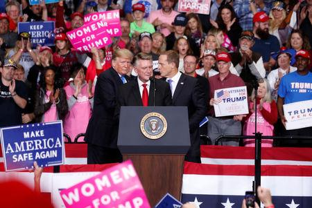 Harris, Republican candidate from North Carolina's 9th Congressional district speaks as U.S. President  Trump looks on during a campaign rally in Charlotte