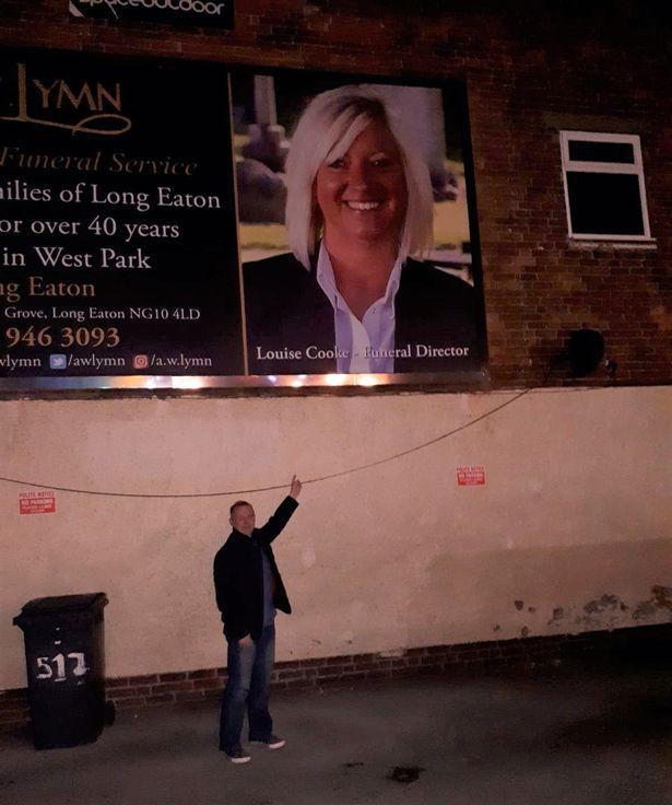 Mick sent Louise a picture of himself next to the huge billboard featuring her face. (Reach)