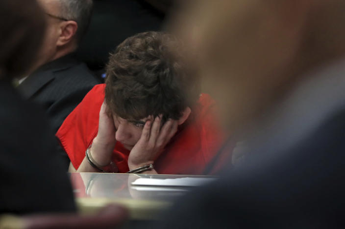 School shooting suspect Nikolas Cruz looks up as two videos of him predicting the Stoneman Douglas High School massacre are played during a hearing at the Broward Courthouse in Fort Lauderdale, Fla., Tuesday, May 28, 2019. Cruz, who faces the death penalty if convicted, is accused of killing 17 and wounding 17 in the February 2018 mass shooting at Marjory Stoneman Douglas High School in Parkland, Fla. (Amy Beth Bennett/South Florida Sun Sentinel via AP, Pool)