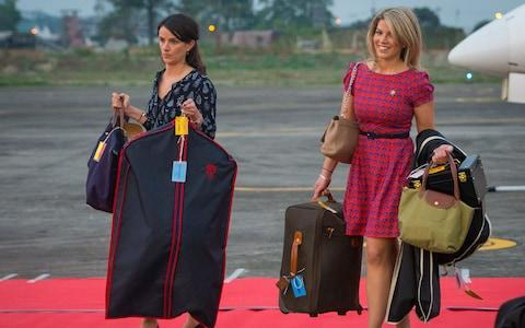Assistant to the Duchess of Cambridge's Private Secretary Sophie Agnew (left) and the Duchess of Cambridge's PA and Stylist Natasha Archer carry items of luggage in India back in 2016 - Credit: Dominic Lipinski/PA