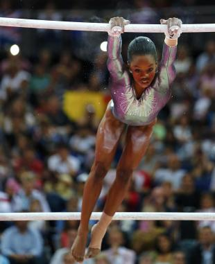 Gabrielle Douglas of the U.S. competes in the women's gymnastics asymmetric bars final in the North Greenwich Arena during the London 2012 Olympic Games August 6, 2012. (REUTERS/Mike Blake)