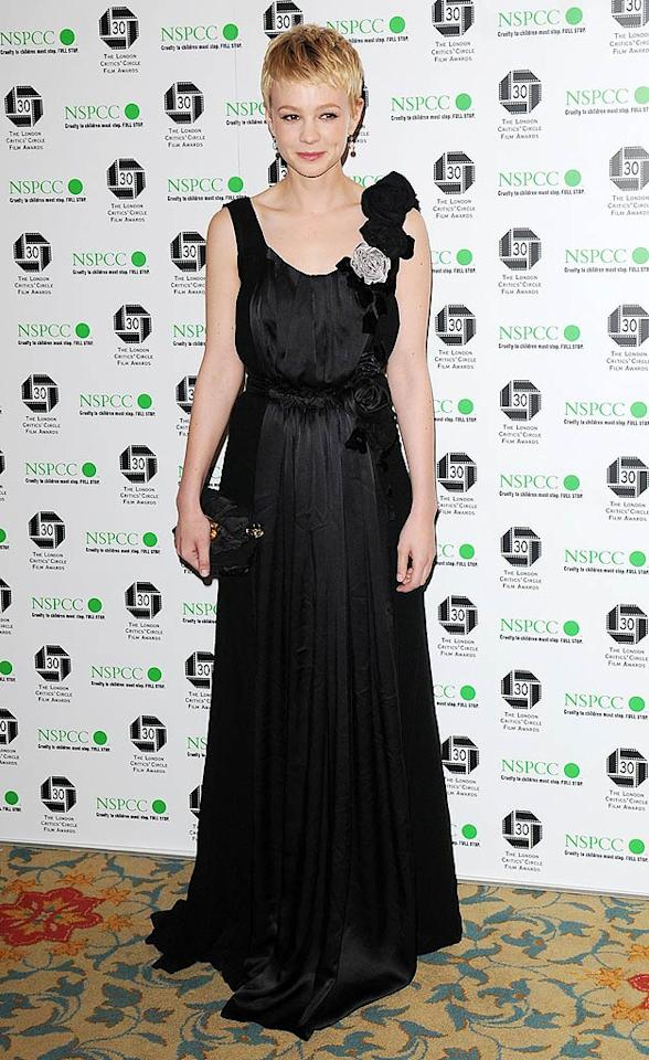 "Carey Mulligan was also spotted in London. Sporting a new 'do, the star of ""An Education"" walked the red carpet at the Critics' Circle Film Awards looking exceptionally elegant in a Nina Ricci gown, which featured rosettes on one of the shoulders. Stuart Wilson/<a href=""http://www.gettyimages.com/"" target=""new"">GettyImages.com</a> - February 18, 2010"