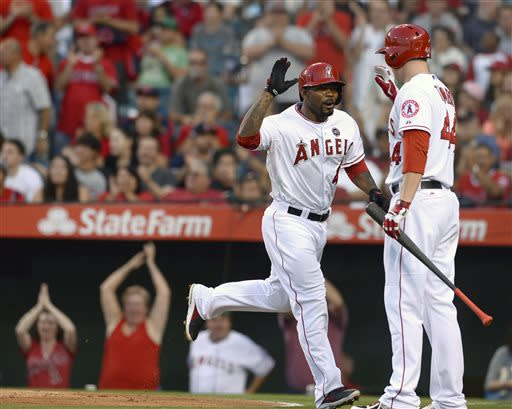 In this photo provided by Angels Baseball LP, Los Angeles Angels' Howie Kendrick (47) high-fives teammate Mark Trumbo (44) after hitting a home run against the Boston Red Sox in the second inning of a baseball game, Saturday, July 6, 2013, in Anaheim, Calif. (AP Photo/Angels Baseball LP, Matt Brown)