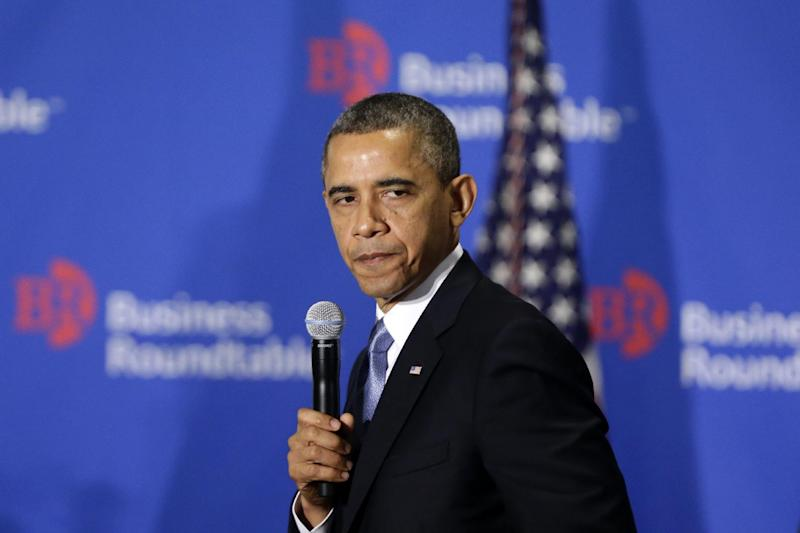 "President Barack Obama pauses as he speaks about the fiscal cliff at the Business Roundtable, an association of chief executive officers, in Washington, Wednesday, Dec. 5, 2012.  The president warned Republicans not to create another fight over the nation's debt ceiling, telling business leaders it's ""not a game that I will play.""  (AP Photo/Charles Dharapak)"