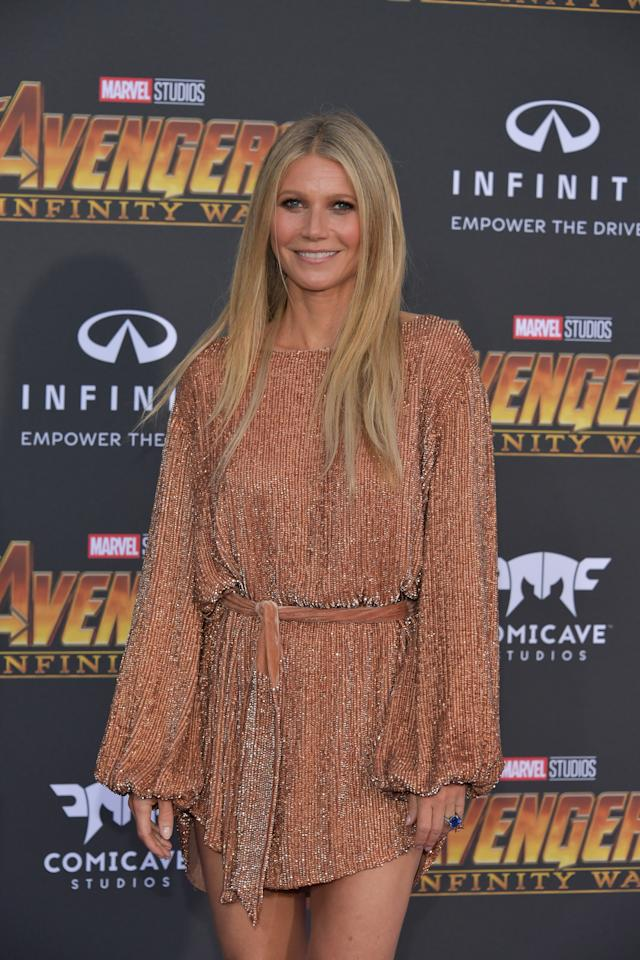 <p>it's a countdown until the actress, who plays Pepper Potts, gets married, so she showed off her engagement ring — a giant blue sapphire — on the carpet. (Photo: Getty Images) </p>