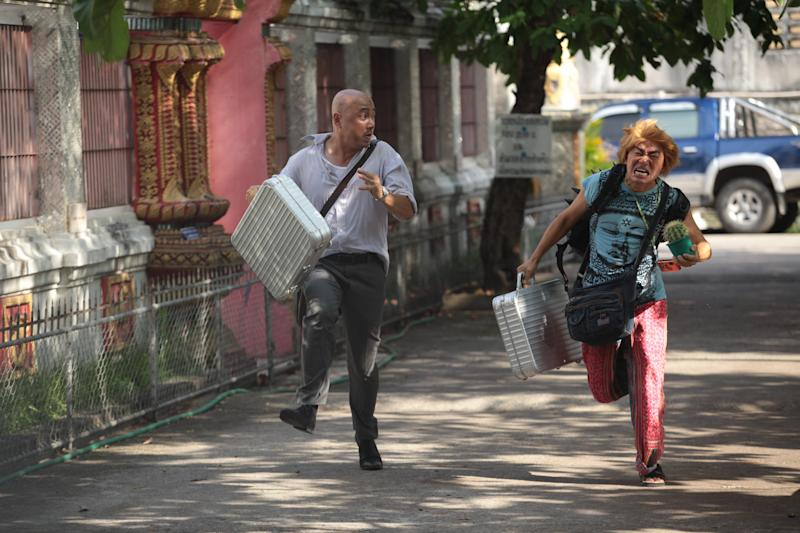 "In this publicity image released by Pegasus Motion Pictures, Xu Zheng, left, and Wang Baoqiang run in a scene from ""Lost in Thailand."" Xu, the director, writer and star of China's biggest box-office hit, says ""Lost in Thailand"" succeeded by showing a rarely seen subject: modern Chinese life. The historical epic, fantasy, action and thriller genres have long filled China's domestic movie screens. But ""Lost in Thailand"" was a low-budget and light-hearted road-trip tale about an ambitious executive who goes to Thailand to get his boss' approval for a business deal. Along the way he's pursued by a rival co-worker and encounters a wacky tourist who helps him rethink his priorities. (AP Photo/Pegasus Motion Pictures)"