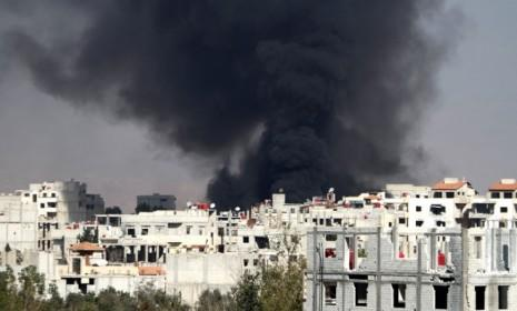 Smoke rises from the eastern Damascus suburb of Arbeenon Nov. 8, after a reported airstrike by a MIG fighter jet.