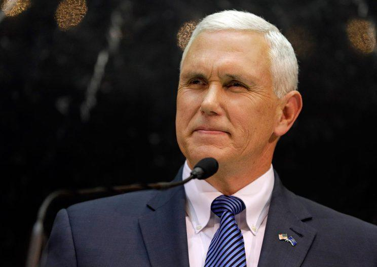 Indiana Gov. Mike Pence delivers his State of the State address, in which he proposed a balanced budget amendment, to a joint session of the legislature in Indianapolis on Jan. 13, 2015. (Photo: Michael Conroy/AP)