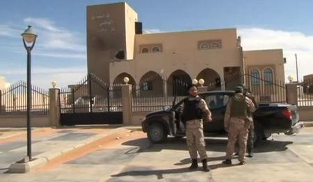 A still image from video released May 17, 2016 shows forces loyal to Libyan unity government outside the National Commercial bank after the recapture of Abu Grain, one of the main checkpoints south of the city of Misrata, Libya from Islamic State. MISRATA TV via REUTERS TV