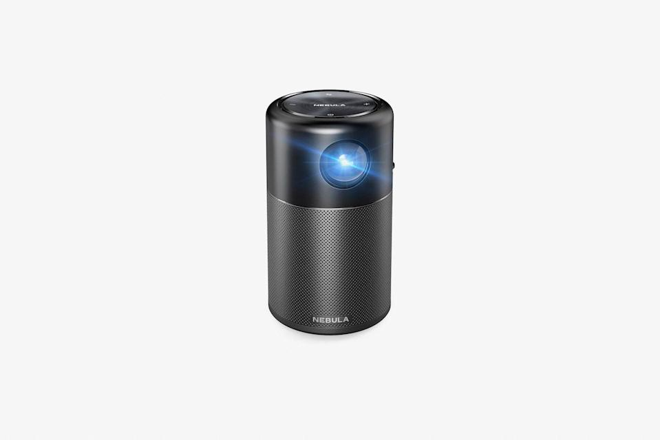 """This soda can-sized pocket projector is ideal for those whose idea of relaxation involves binge-watching Netflix all day long. It lets you enjoy a movie night in your backyard, at a campsite, or even on the beach, and offers four hours of playtime with each charge, plus 360-degree sound, making it a must-have for trips and staycations alike. Even better: The projection is more than eight feet wide, so you have your own private theater anywhere you go. $300, Anker. <a href=""""https://www.anker.com/store/nebula-capsule/D4111111?"""" rel=""""nofollow noopener"""" target=""""_blank"""" data-ylk=""""slk:Get it now!"""" class=""""link rapid-noclick-resp"""">Get it now!</a>"""