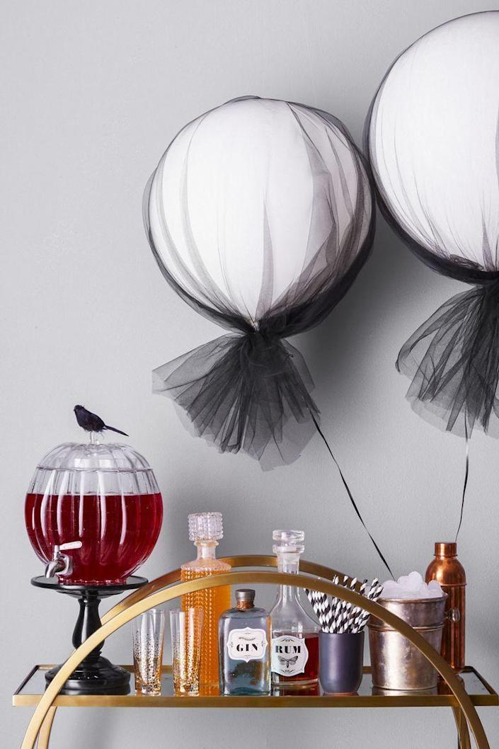 """<p>Trick out your bar cart for Halloween with this cute cocktail station idea.</p><p><strong><em>Get the tutorial at <a href=""""https://www.goodhousekeeping.com/holidays/halloween-ideas/a46024/halloween-labels/"""" rel=""""nofollow noopener"""" target=""""_blank"""" data-ylk=""""slk:Good Housekeeping"""" class=""""link rapid-noclick-resp"""">Good Housekeeping</a>.</em></strong></p><p><a class=""""link rapid-noclick-resp"""" href=""""https://www.amazon.com/Nakpunar-Liquor-Synthetic-Stopper-Regular/dp/B01LI5R2RE?tag=syn-yahoo-20&ascsubtag=%5Bartid%7C10070.g.1908%5Bsrc%7Cyahoo-us"""" rel=""""nofollow noopener"""" target=""""_blank"""" data-ylk=""""slk:SHOP CLEAR DECANTERS"""">SHOP CLEAR DECANTERS</a></p>"""