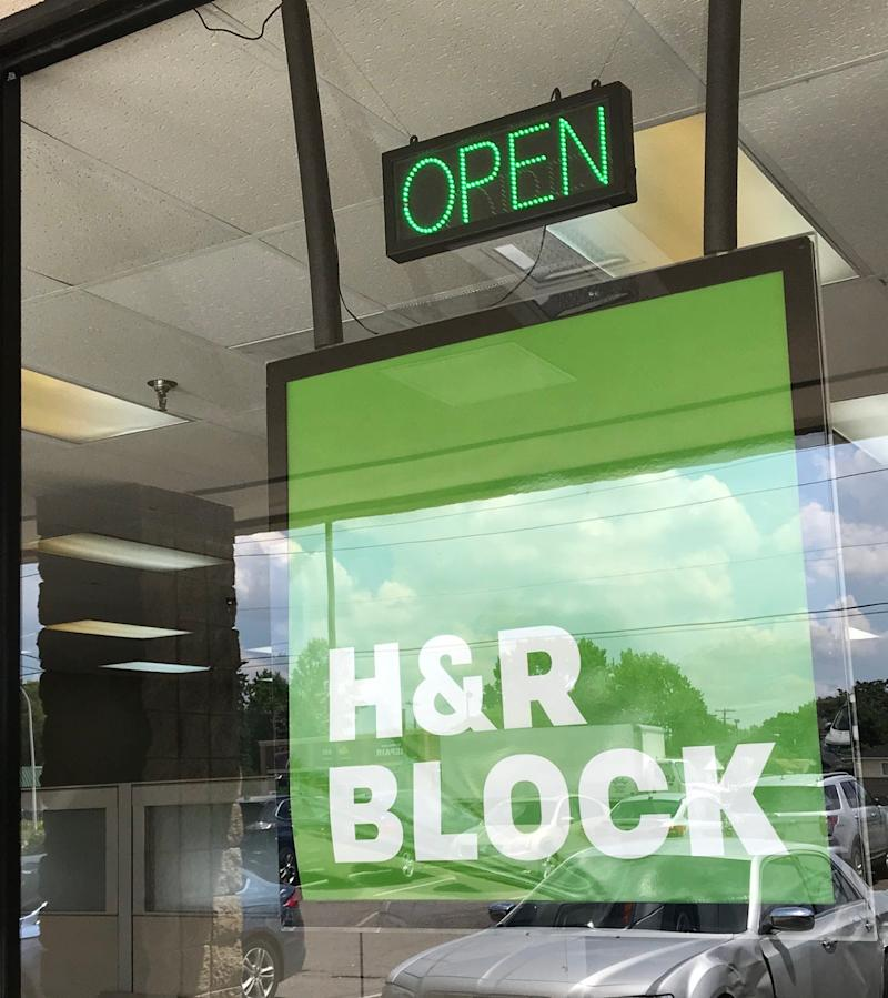 Some storefronts of national tax chains, such as H&R Block, are open for business in July as we approach a July 15 tax deadline. While most people have filed their taxes already, millions took advantage of a COVID-19 related extension. An H&R Block office window in Madison Heights, Mich., on July 1, 2020.