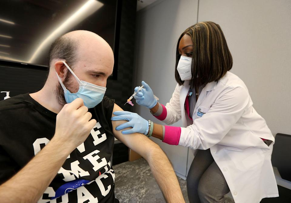 Starlena Moore administers a COVID-19 vaccine to Jimmy Else, 35, at the offices of YAI in New York City, Dec. 28. 2020. YAI is an agency that provides services to individuals with intellectual and/or developmental disabilities.