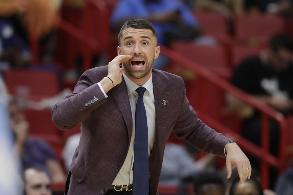 Minnesota Timberwolves head coach Ryan Saunders calls out a play during the second half of an NBA basketball game against the Miami Heat, Wednesday, Feb. 26, 2020, in Miami. (AP Photo/Wilfredo Lee)