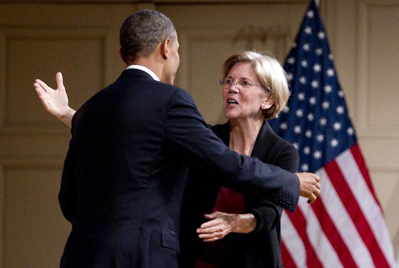 President Barack Obama is embraced by Elizabeth Warren as he arrives to speak at a campaign event at Symphony Hall, Monday, June 25, 2012, in Boston. (AP Photo/Carolyn Kaster)