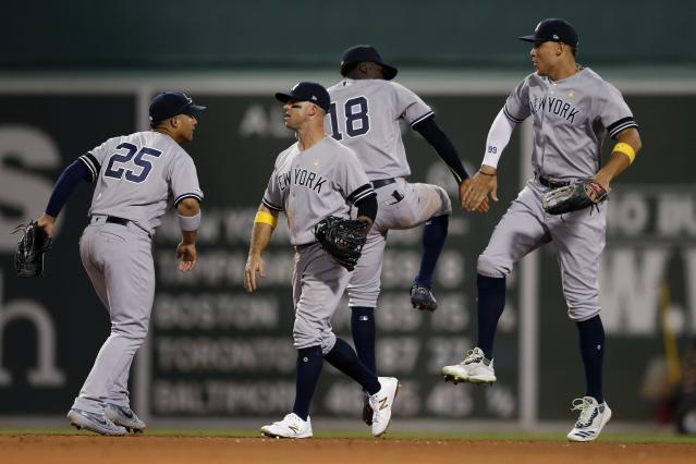 New York Yankees' Gleyber Torres (25), Brett Gardner, center left, Didi Gregorius (18) and Aaron Judge, right, celebrate after defeating the Boston Red Sox during a baseball game in Boston, Saturday, Sept. 7, 2019. (AP Photo/Michael Dwyer)