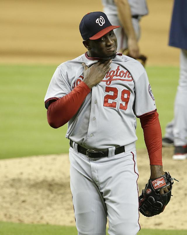 Washington Nationals relief pitcher Rafael Soriano (29) walks to the dugout after being relieved in the ninth inning during a baseball game against the Miami Marlins, Monday, July 28, 2014, in Miami. The Marlins scored four runs in the ninth inning to come from behind and defeat the Nationals 7-6. (AP Photo/Lynne Sladky)