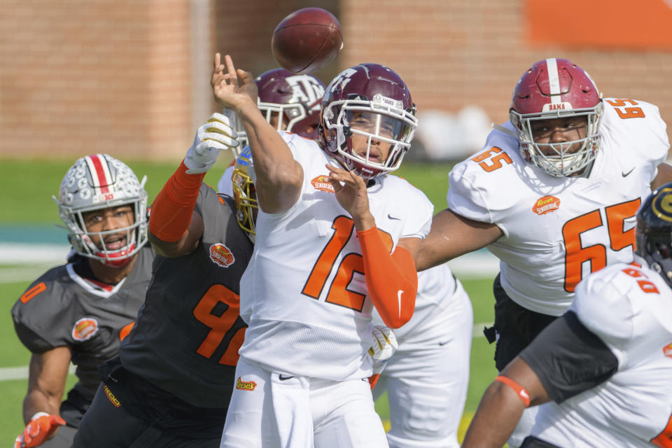 American Team quarterback Kellen Mond of Texas A&M (12) has his throw tipped by National Team offensive lineman Osa Odighizuwa of UCLA (92) during the first half of the NCAA Senior Bowl college football game in Mobile, Ala., Saturday, Jan. 30, 2021. (AP Photo/Matthew Hinton)
