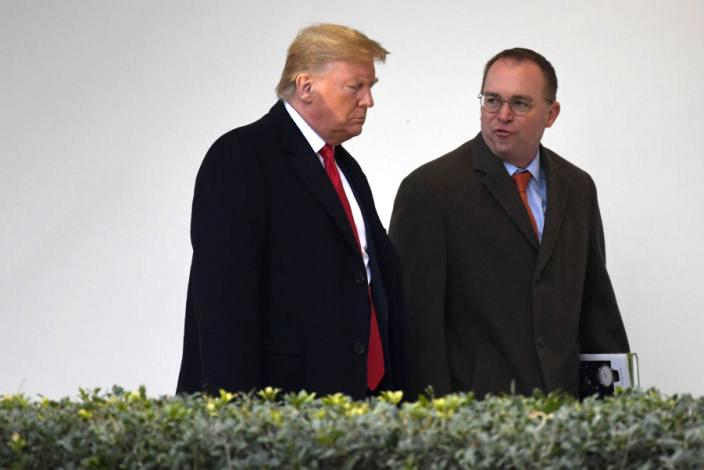 President Trump with acting White House chief of staff Mick Mulvaney, January 2020. (Susan Walsh/AP)