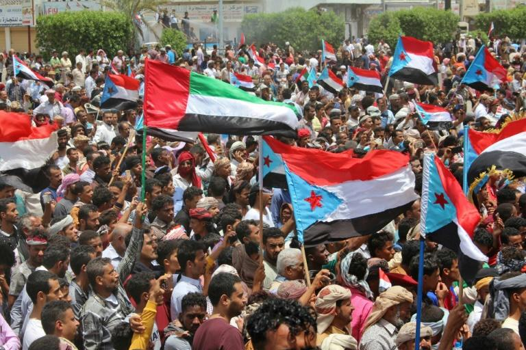 Demonstrators in Yemen's second city Aden took to the streets after its seizure by separatist forces, waving flags of the formerly independent South Yemen and of the UAE
