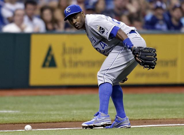 Kansas City Royals third baseman Miguel Tejada keeps an eye on Tampa Bay Rays' Desmond Jennings as Jennings' infield single rolls up the third base line during the fourth inning of a baseball game, Friday, June 14, 2013, in St. Petersburg, Fla. (AP Photo/Chris O'Meara)