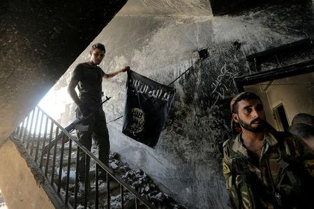A member of the Syrian Democratic Forces calls his comrades during the fighting with Islamic State fighters in Raqqa