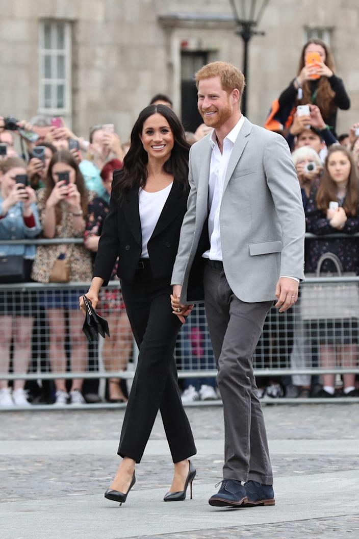 """<div class=""""caption""""> Prince Harry, Duke of Sussex and Meghan, Duchess of Sussex visit Trinity College on the second day of their official two day royal visit to Ireland on July 11, 2018 in Dublin, Ireland. </div> <cite class=""""credit"""">Pool</cite>"""