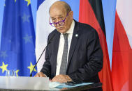 """FILE - In this Friday, Sept. 10, 2021 file photo, French Foreign Minister Jean-Yves Le Drian speaks in Weimar, Germany. France said late Friday, Sept. 17 it was immediately recalling its ambassadors to the U.S. and Australia after Australia scrapped a big French conventional submarine purchase in favor of nuclear subs built with U.S. technology. Foreign Minister Jean-Yves Le Drian said in a written statement that the French decision, on request from President Emmanuel Macron, """"is justified by the exceptional seriousness of the announcements"""" made by Australia and the United States.(Jens Schlueter/Pool Photo via AP, file)"""
