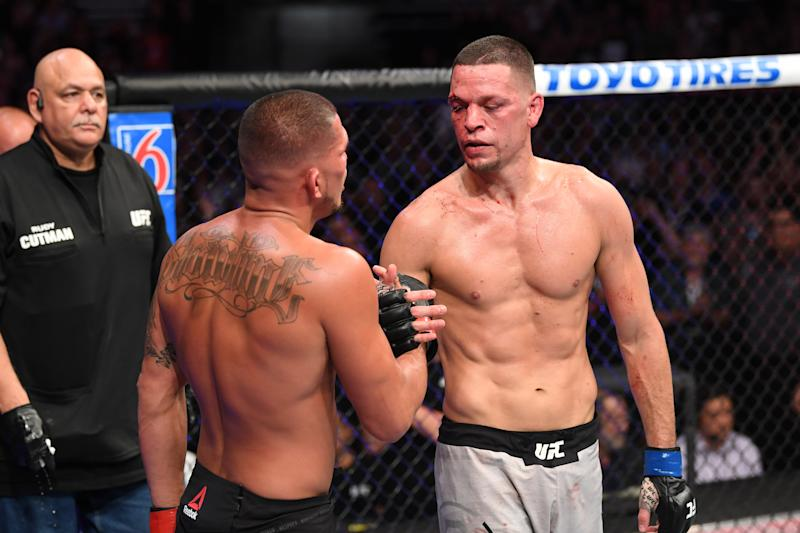 ANAHEIM, CALIFORNIA - AUGUST 17: (R-L) Nate Diaz and Anthony Pettis embrace after their welterweight bout during the UFC 241 event at the Honda Center on August 17, 2019 in Anaheim, California. (Photo by Josh Hedges/Zuffa LLC/Zuffa LLC via Getty Images)