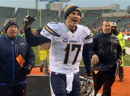 Jan 5, 2014; Cincinnati, OH, USA; San Diego Chargers quarterback Philip Rivers (17) celebrates at the end of the 2013 AFC wild card playoff football game against the Cincinnati Bengals at Paul Brown Stadium. Mandatory Credit: Kirby Lee-USA TODAY Sports