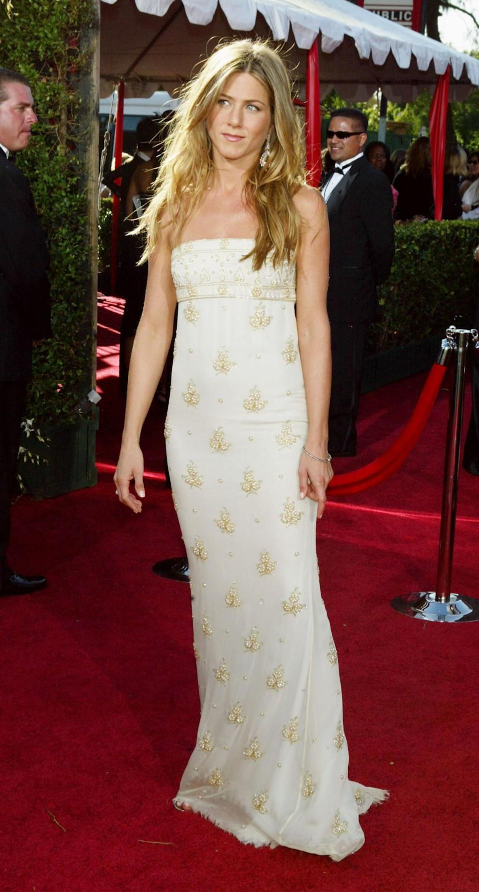 <p>Jennifer looked like a blushing bride at the 2004 Emmys in a strapless white gown. <i>[Photo: Getty]</i> </p>