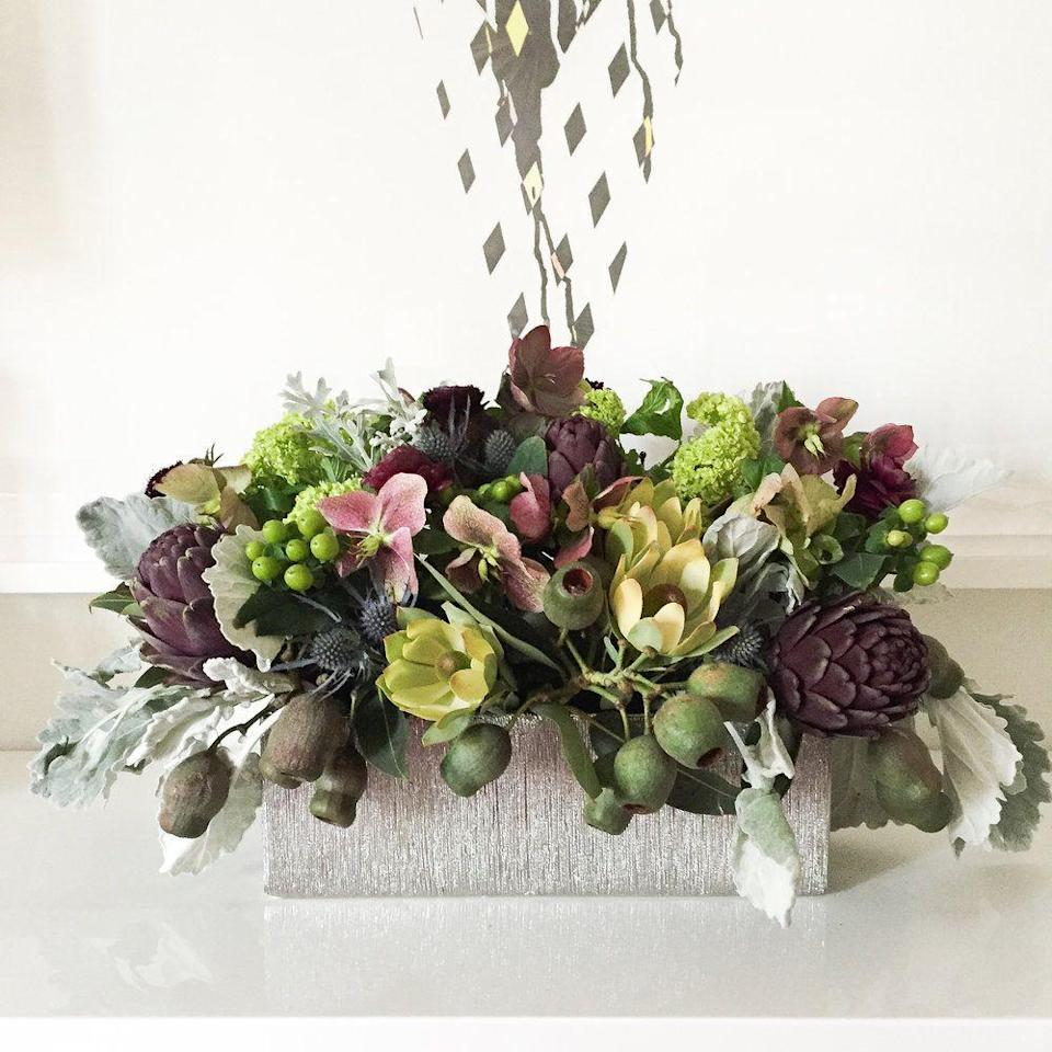 "<p>For the decorator who wants to make a big statement in an understated way, follow this centerpiece's formula. Though the flowers are in a subdued palette, the arrangement is energized by the thistle, hypericum, artichokes, and, most notably, eucalyptus pods. </p><p><em>Via <a href=""http://www.darlingtonavenue.com"" rel=""nofollow noopener"" target=""_blank"" data-ylk=""slk:Darlington Avenue"" class=""link rapid-noclick-resp"">Darlington Avenue</a> </em></p>"